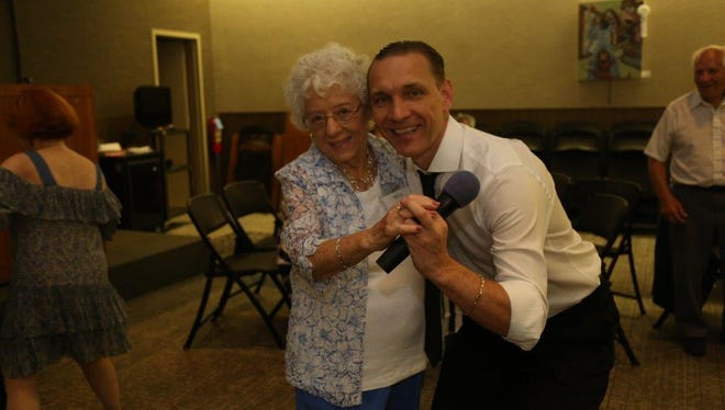 Sergei Bezrodnov from Ballroom Dance of NJ gives some pointers to Sylvia Federico, of Berkeley Heights.