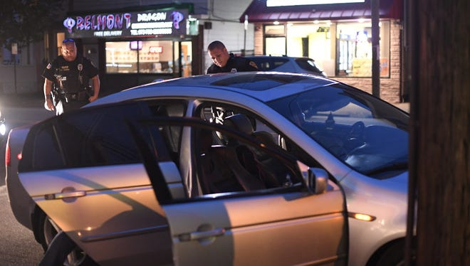 Haledon police officers search a car after detecting an odor of marijuana during a vehicle stop on Belmont avenue while on patrol in Haledon, NJ on Thursday, May 4, 2017.