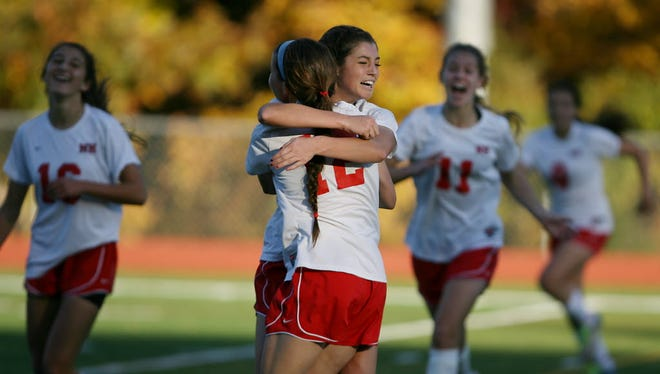 Madison Holleran (#3) celebrates with  Emma Sullivan (#12) after she scored a goal in the second quarter to give NH a 1-0 lead on Nov. 5, 2011.