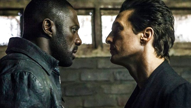 """Idris Elba, left, and Matthew McConaughey in the Columbia Pictures film, The Dark Tower.""""  The movie is playing at Regal West Manchester Stadium 13, Frank Theatres Queensgate Stadium 13 and R/C Hanover Movies."""