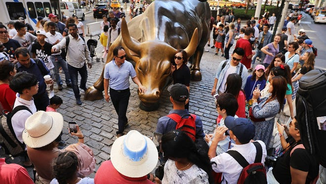 The Dow Jones Industrial Average hit the 22,000 milestone on Wednesday, continuing its climb.