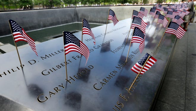 American flags were inserted in each of the 2,983 names on the 9/11 Memorial, in New York, Tuesday, July 4, 2017.