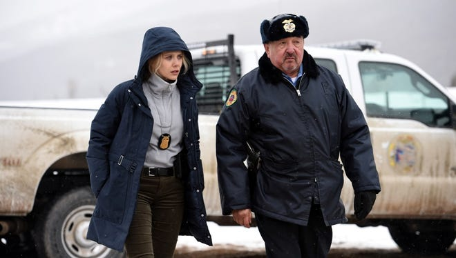 """Elizabeth Olsen and Graham Green in a scene from """"Wind River."""""""