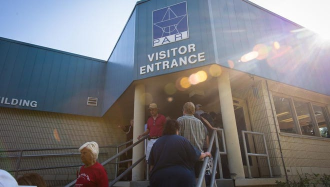 Visitors to the Pisgah Astronomical Research Institute in Rosman enter the visitor center for speakers and other programming on the day of the solar eclipse, Aug. 21, 2017.
