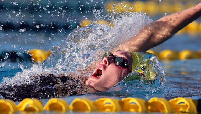 Taylor Ruck of Scottsdale set a World Junior Swimming Championships record Wednesday in the 100-meter backstroke.