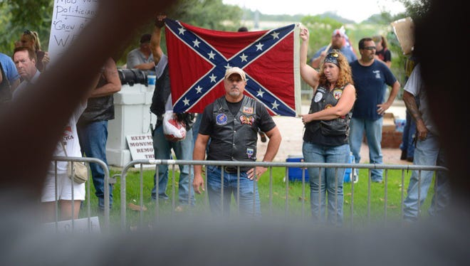 Protesters and counter-protesters exchange tense words during a rally Saturday, Aug. 26, 2017, at Lee Square in Pensacola.
