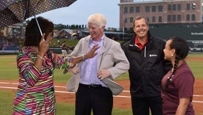 Craig Brown receives an honorary MedEx jacket, along with surprise news of a $50,000 MedEx Academy scholarship in his honor, during Wednesday's night Greenville Drive game. From left to right, Brenda Thames of GHS, Brown, Spence Taylor of GHS and MedEx alumni/current medical school student Kelsey Williams
