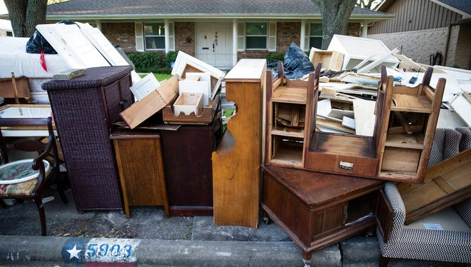 In this Wednesday, Sept. 6, 2017, photo flood damaged furniture sets in front of a home in the aftermath of Hurricane Harvey in Houston. Harvey's record-setting rains now have the potential to set records for the amount of debris one storm can produce. (AP Photo/Matt Rourke)