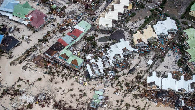 This Sept. 6, 2017 photo provided by the Dutch Defense Ministry shows storm damage in the aftermath of Hurricane Irma, in St. Maarten. Irma cut a path of devastation across the northern Caribbean, leaving thousands homeless after destroying buildings and uprooting trees.