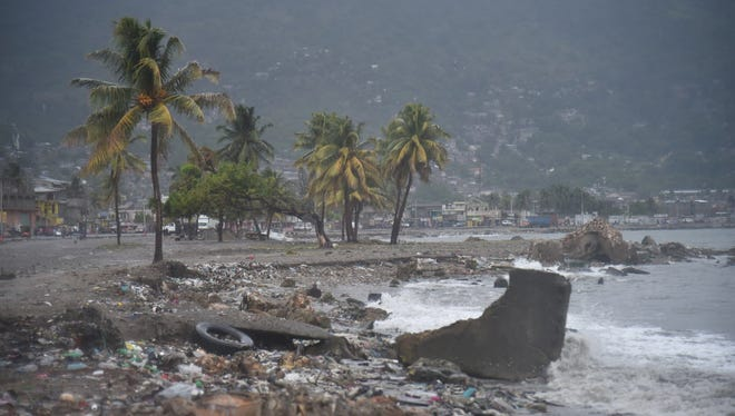 Debris and trash is seen on a beach in Cap-Haitien on September 7, 2017, as Hurricane Irma approaches.