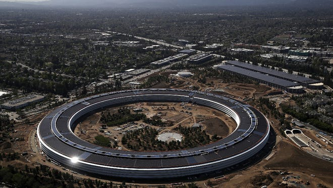 """An aerial view of the new Apple headquarters in Cupertino, California. Apple's new 175-acre """"spaceship"""" campus dubbed Apple Park. It was designed by Lord Norman Foster and cost roughly $5 billion. It will house 12,000 employees in over 2.8 million square feet of office space and will have nearly 80 acres of parking to accommodate 11,000 cars."""