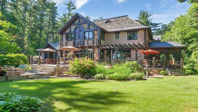 A timber-framed mansion sits on a heavily-wooded 3.5 acre lot at 3983 Pine Point Road in Sartell.