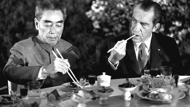 Chinese Premier Chou En-lai and President Richard Nixon at a banquet in Shanghai, February 28, 1972.