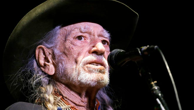"""FILE - In this Jan. 7, 2017, file photo, Willie Nelson performs in Nashville, Tenn. Organizers of the """"Harvey Can't Mess With Texas"""" benefit concert announced on Wednesday, Sept. 13, that Nelson, Bonnie Raitt, Paul Simon and James Taylor are among the stars headlining the four-hour show scheduled for Sept. 22 in Austin that will raise money for victims of Hurricane Harvey. (AP Photo/Mark Humphrey, File)"""