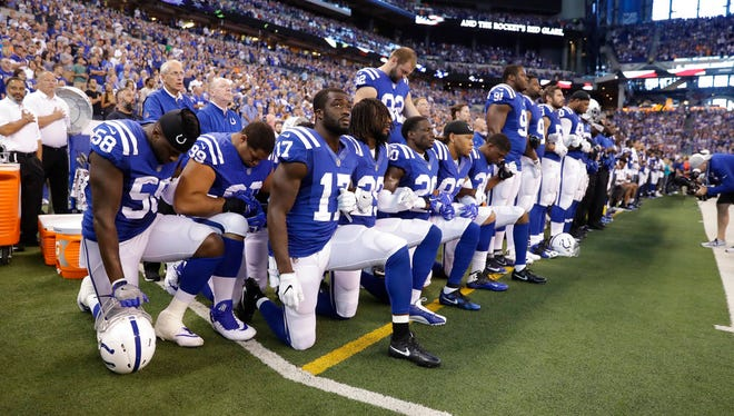 In this file photo, members of the Indianapolis Colts take a knee during the Nation Anthem before an NFL football game against the Cleveland Browns in Indianapolis, Sunday, Sept. 24, 2017. (AP Photo/Darron Cummings)