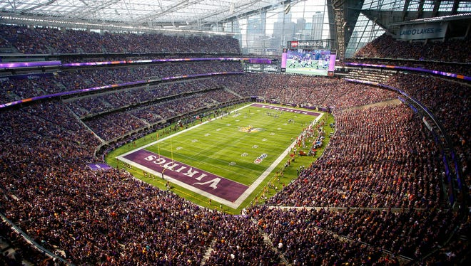 In this Nov. 2017 photo, fans cheer in U.S. Bank Stadium during the second half of an NFL football game between the Minnesota Vikings and the Tampa Bay Buccaneers in Minneapolis. U.S. Bank Stadium officials announced Tuesday Sept. 26, 2017, that they have fired the firm that was providing security at the facility, after an investigation showed it didn't comply with state regulations and licensing rules.
