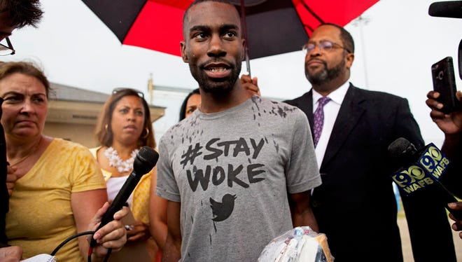 Black Lives Matter activist DeRay Mckesson talks to the media after his release from the Baton Rouge jail in Baton Rouge, La. on July 10, 2016.