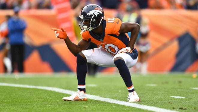 Oct 1, 2017; Denver, CO, USA; Denver Broncos wide receiver Emmanuel Sanders (10) celebrates his first down reception made in the third quarter against the Oakland Raiders at Sports Authority Field at Mile High. Mandatory Credit: Ron Chenoy-USA TODAY Sports