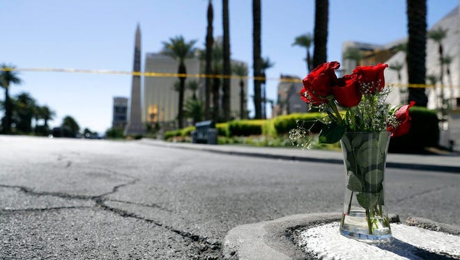 Flowers are placed near the scene of a mass shooting at a music festival near the Mandalay Bay resort and casino on the Las Vegas Strip.  AP photo Flowers are placed near the scene of a mass shooting at a music festival near the Mandalay Bay resort and casino, top left, on the Las Vegas Strip, Monday, Oct. 2, in Las Vegas.