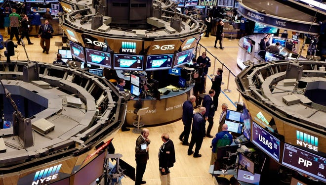 In this Thursday, Feb. 9, 2017, file photo, traders work the floor at the New York Stock Exchange.