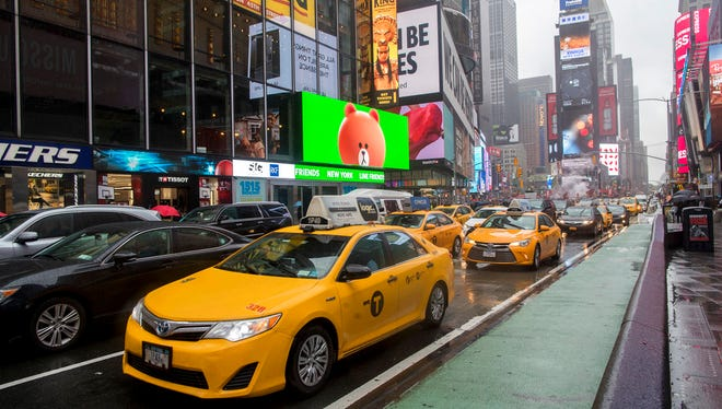 Traffic makes its way down Seventh Avenue in New York's Times Square. Cruise Automation, a self-driving software company owned by General Motors, will start testing in New York in early 2018.