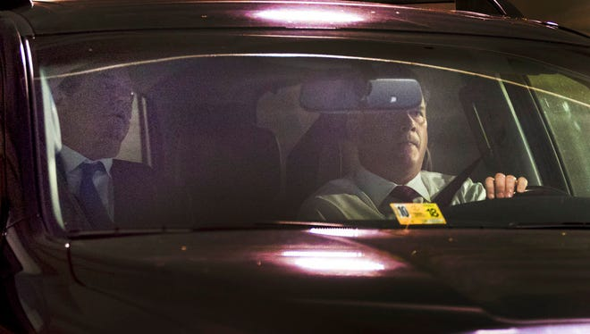 Former Trump Campaign Chairman Paul Manafort, left, leaves his home in Alexandria, Va., Monday, Oct. 30, 2017, in Washington.