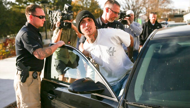 Austin Boutain, a suspect in Monday night's fatal shooting of University of Utah student ChenWei Guo, is led out of the University of Utah Department of Public Safety in Salt Lake City, Tuesday, Oct. 31.