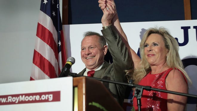 GOP Senate nominee Roy Moore and wife Kayla, Montgomery, Ala., Sept. 27, 2017