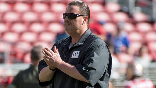 New York Giants head coach Ben McAdoo watches warm ups before the game against the San Francisco 49ers at Levi's Stadium.