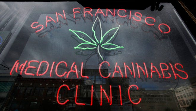 FILE - This Oct. 19, 2009 file photo shows a neon sign at the entrance to the San Francisco Medical Cannabis Clinic in San Francisco.