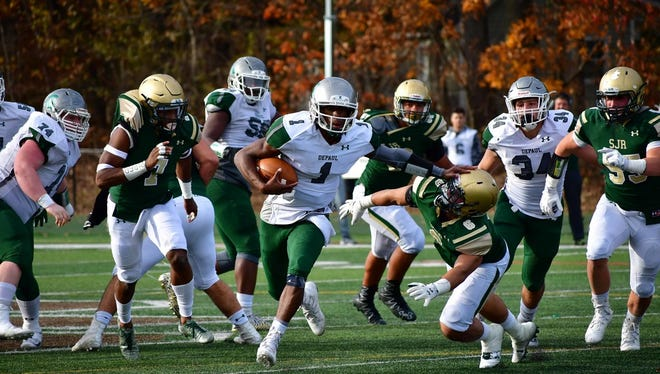 DePaul's Ta'Quan Roberson (1) completed 15 of 17 passes for 186 yards and six touchdowns against St. John Vianney.