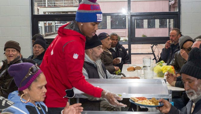 Last year, during the Thanksgiving season, Giants players helped served meals at Eva's Village in Paterson.