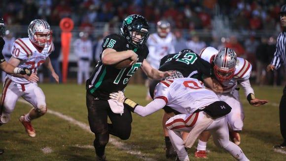 Mountain Heritage quarterback Trey Robinson runs the
