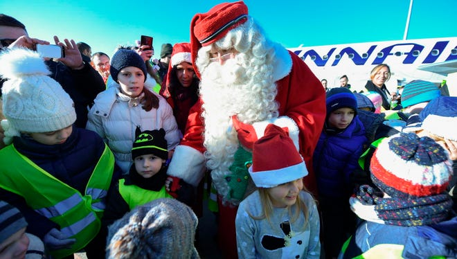 The Santa Claus from Lapland of Finland, Joulupukki, greets children at Liszt Ferenc airport in Budapest on Dec. 1, 2017 as he arrives for a few-day-trip to celebrate Santa Claus Day on December 06.
