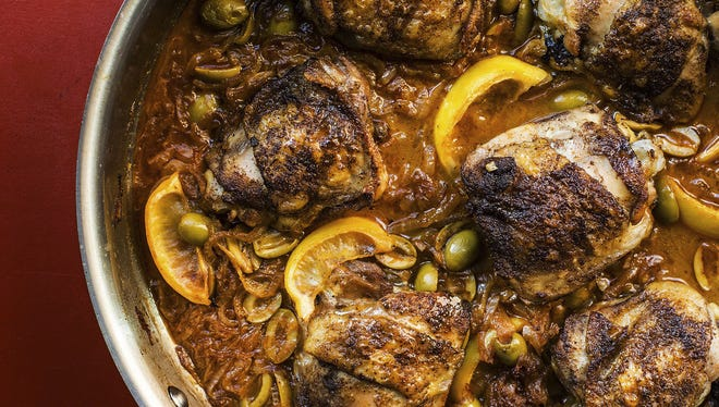 This February 2017 photo shows braised chicken with green olives and onions.