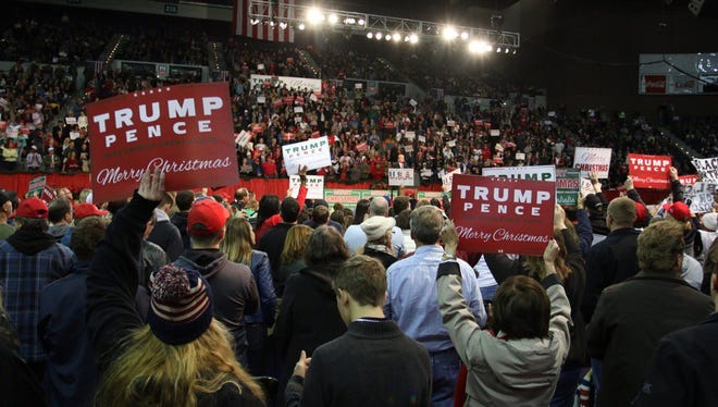 Crowds stand up in support of President Trump at the Pensacola Bay Center on Friday, Dec. 8, 2017.