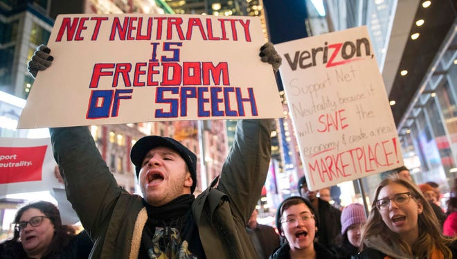 "In this Thursday, Dec. 7, 2017, file photo, demonstrators rally in support of net neutrality outside a Verizon store in New York. The Federal Communications Commission is voting Thursday, Dec. 14 to undo Obama-era ""net neutrality"" rules that guaranteed equal access to the internet. The industry promises that the internet experience isn't going to change, but the issue has struck a nerve. Protests have erupted online and in the streets as everyday Americans worry that companies like Comcast, Verizon and AT&T will be able to control what they see and do online."
