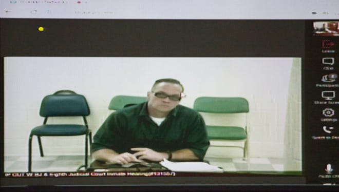 Death row inmate Scott Dozier appears for his court hearing via video at the Regional Justice Center in Las Vegas, Tuesday, Dec. 5, 2017.