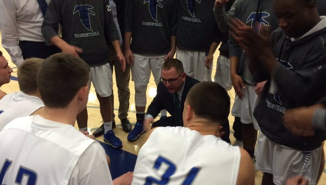 Cedar Crest coach Tom Smith talks to his team prior to Friday Night's matchup with Hempfield. The Falcons picked up a huge victory, knocking off previously unbeaten Hempfield 41-39 and pulling into a tie for first place in Section 1.