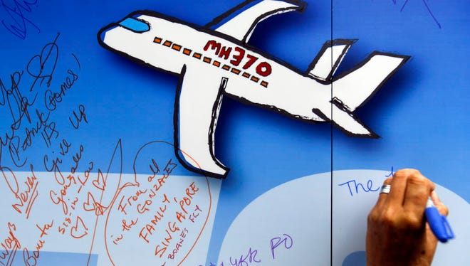 Well wishes are written on a wall of hope March 6, 2016, during a remembrance event for Malaysia Airlines Flight 370 in Kuala Lumpur. The Malaysian government has approved a new attempt to find the wreckage of the flight in the Indian Ocean.