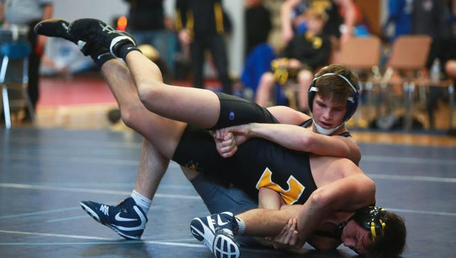 """Enka's Phil Daub wrestles Hunter Trull of Tuscola at the """"Enka Duals'' tournament on Saturday morning at Enka.  Daub pinned Trull in 30 seconds to break the WNC record for most wins with his 206th."""