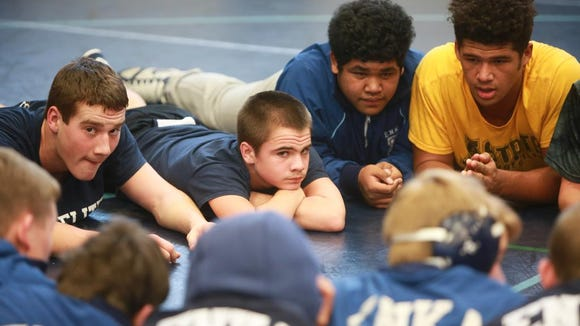 "Scenes from the ""Enka Duals'' wrestling tournament on Saturday morning at Enka High School."