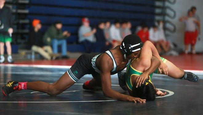 "Scenes from the ""Enka Duals'' wrestling tournament on Saturday morning at Enka High School."