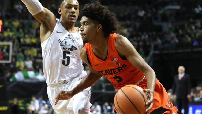 Jan 27, 2018; Eugene, OR, USA;  Oregon State guard Ethan Thompson (5) drives on Oregon guard Elijah Brown (5) in the first half at Matthew Knight Arena. Mandatory Credit: Jaime Valdez-USA TODAY Sports