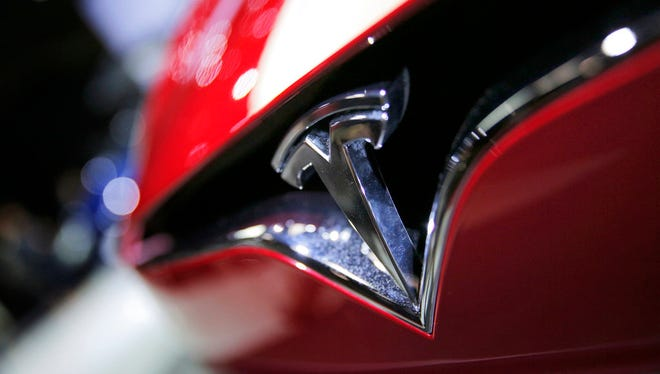 This Sept. 30, 2016, file photo shows the logo of the Tesla Model S on display at the Paris Auto Show in Paris.