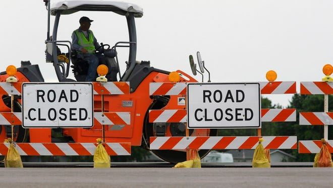 Road construction crews work June 22, 2016, to build a four-lane highway on Route 29 in Edinburg, Ill.