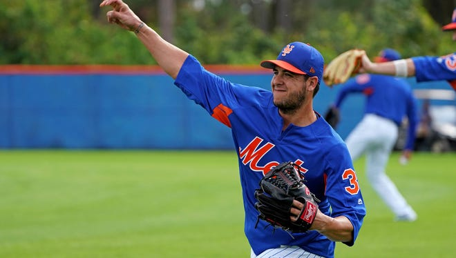New York Mets relief pitcher Anthony Swarzak (38) warms up during a workout at First Data Field.