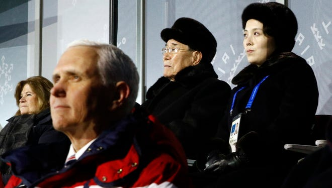 In this Feb. 9, 2018 file photo, Kim Yo Jong, top right, sister of North Korean leader Kim Jong Un, sits alongside North Korea's nominal head of state Kim Yong Nam, and behind U.S. Vice President Mike Pence as she watches the opening ceremony of the 2018 Winter Olympics in Pyeongchang,
