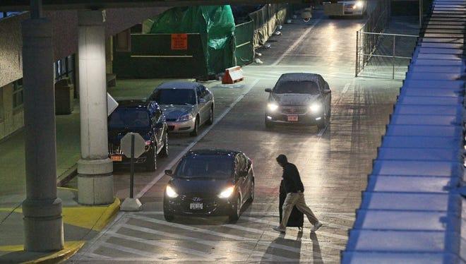 A pedestrian walks toward the terminal at Mitchell International Airport in Milwaukee.