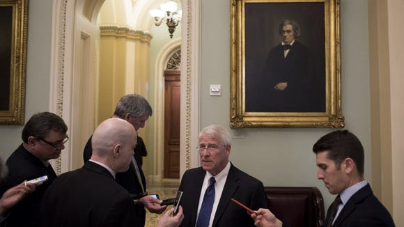 Sen. Roger Wicker, R-Miss., speaks with reporters at